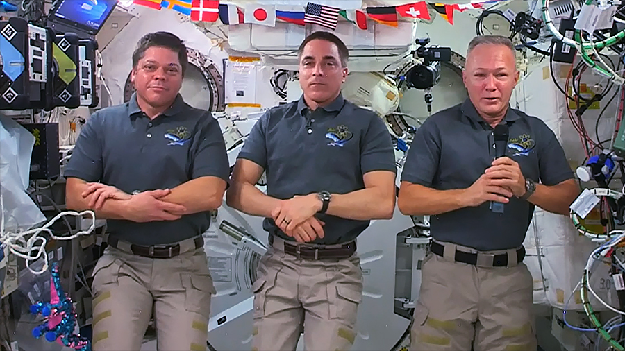 NASA astronauts (from left) Bob Behnken, Chris Cassidy and Doug Hurley talk to journalists on Earth. The trio answered media questions before Behnken and Hurley return to Earth.
