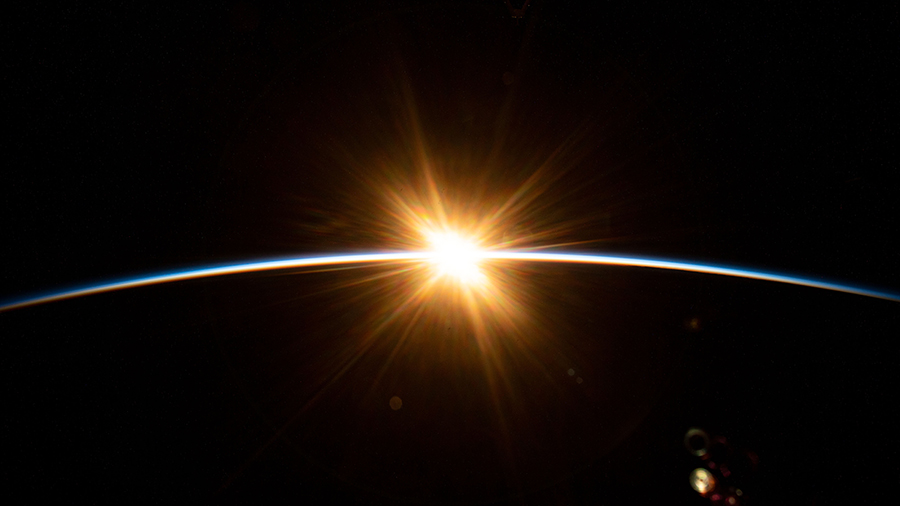 The sun's first rays burst over the Earth's horizon during an orbital sunrise as the International Space Station orbited above the Indian Ocean southwest of Australia.