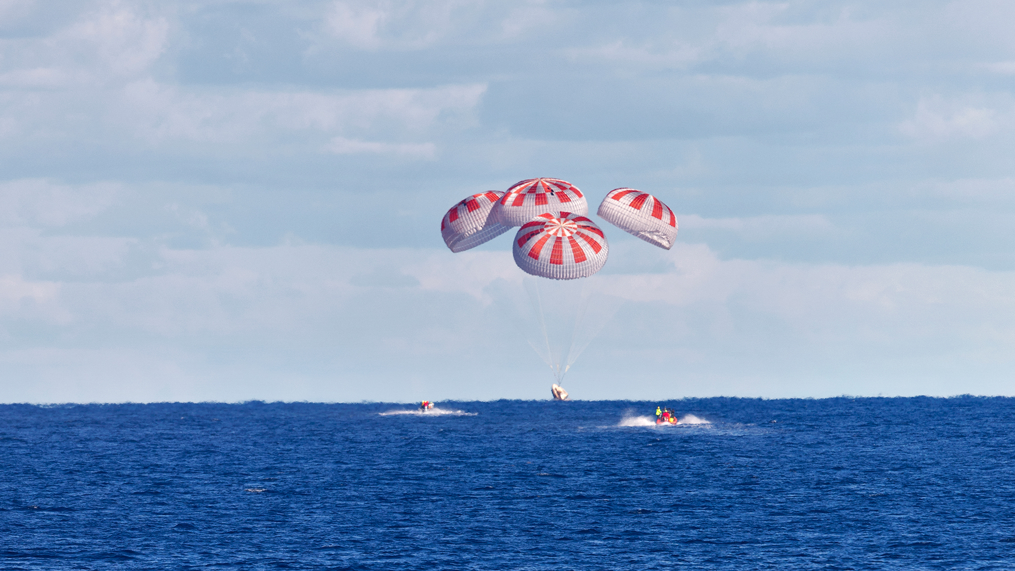 SpaceX's first Crew Dragon parachutes to a splashdown in the Atlantic Ocean during the uncrewed Demo-1 mission on March 8, 2019.