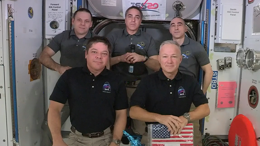 The SpaceX Crew Dragon astronauts (front row, from left) Bob Behnken and Doug Hurley joined their Expedition 63 crewmates (rear, from left) Ivan Vagner, Chris Cassidy and Anatoly Ivanishin for a crew farewell ceremony Saturday morning. Credit: NASA TV