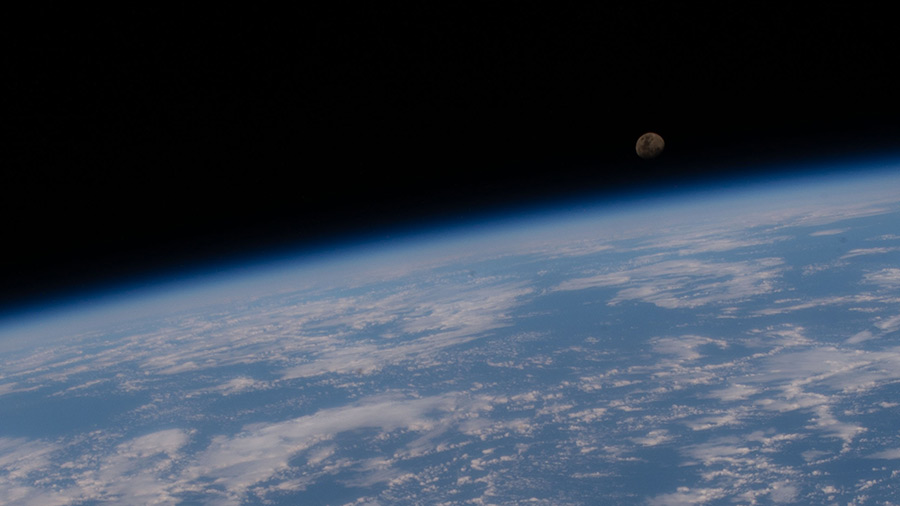 A waxing gibbous moon is pictured above the Earth's horizon as the station orbited above the Atlantic Ocean off the coast of Brazil.