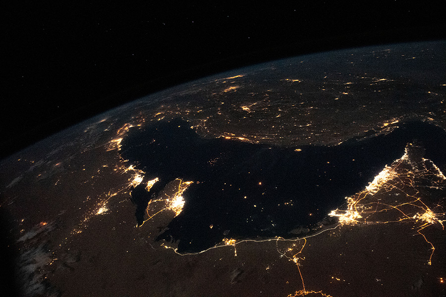 The well-lit Middle Eastern cities along the Persian Gulf coast of the Arabian Peninsula to the north of Iran were photographed from the International Space Station during an orbital night pass.