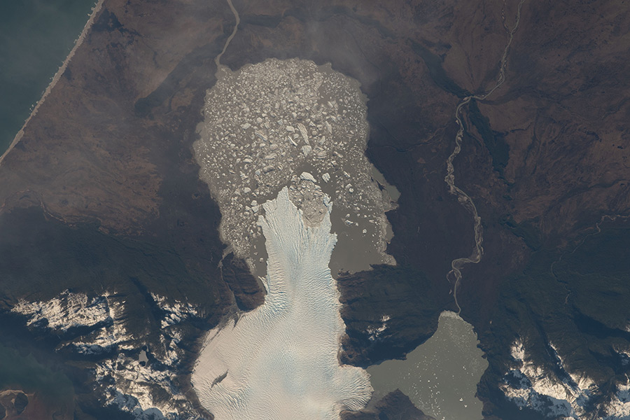 A glacier, pictured from the International Space Station, in the Laguna San Rafael National Park ends at the Rio Nevado in Aysén, Chile.