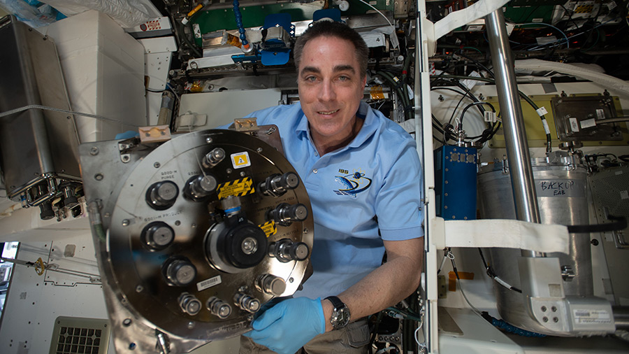 Expedition 63 Commander Chris Cassidy replaces components inside the Waste and Hygiene Compartment, the International Space Station's bathroom located inside the Tranquility module.