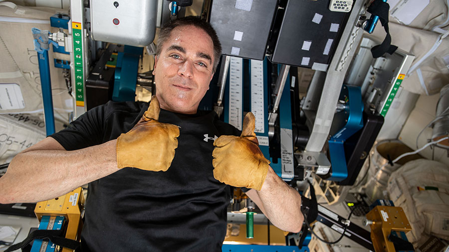 Expedition 63 Commander Chris Cassidy gives a thumbs up during set up of space station exercise equipment.