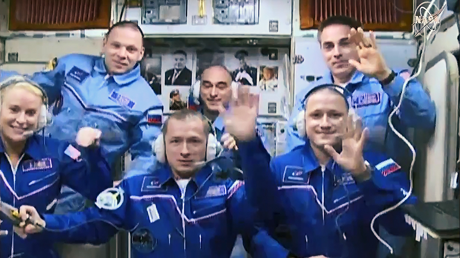 (Front row from left) Expedition 64 crew members Kate Rubins, Sergey Ryzhikov and Sergey Kud-Sverchkov join Expedition 63 crew members (back row from left) Ivan Vagner, Anatoly Ivanishin and Chris Cassidy inside the space station's Zvezda service module.