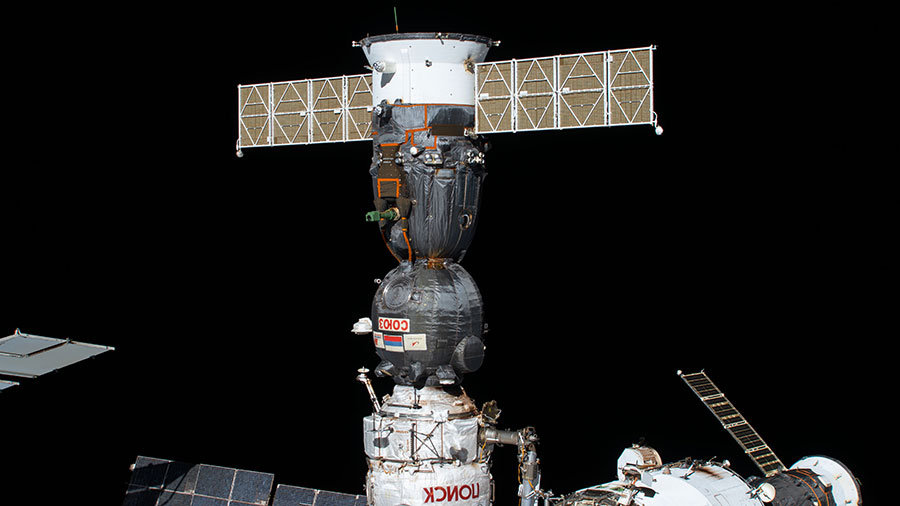 The Soyuz MS-16 crew ship is pictured docked to the International Space Station's Poisk module.