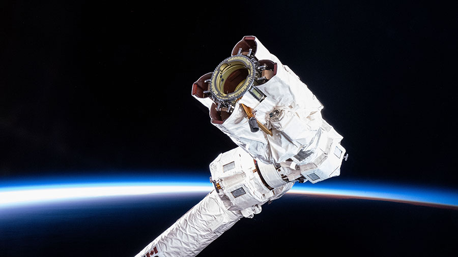 The tip of the Canadarm2 robotic arm which grapples hardware, science experiments and approaching spaceships, is pictured as the station soared over the South Pacific Ocean.