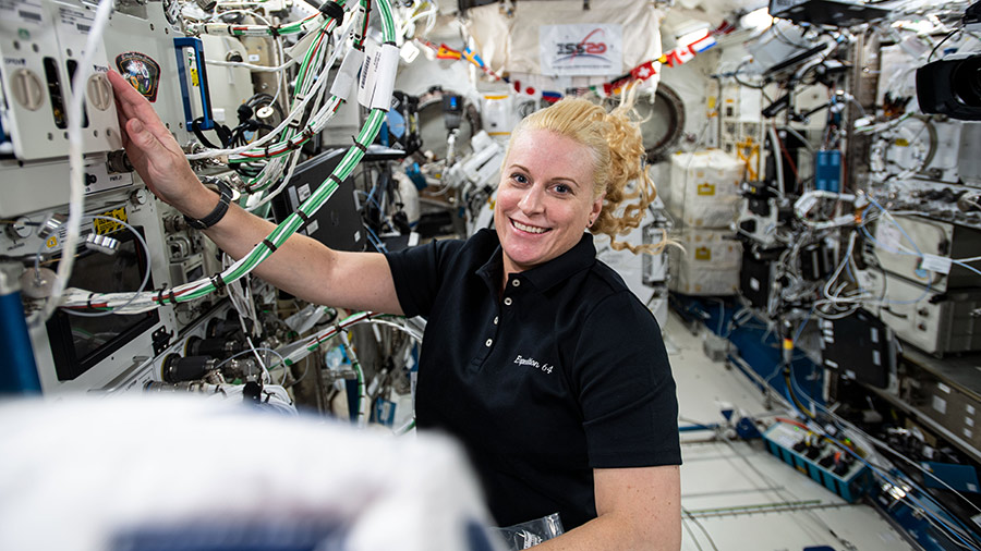 Expedition 64 Flight Engineer Kate Rubins works on research hardware inside the Kibo laboratory module.