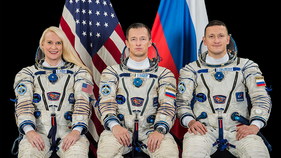 Expedition 64 crew members (from left) NASA astronaut Kate Rubins and Roscosmos cosmonauts Sergey Ryzhikov and Sergey Kud-Sverchkov pose for a crew portrait.