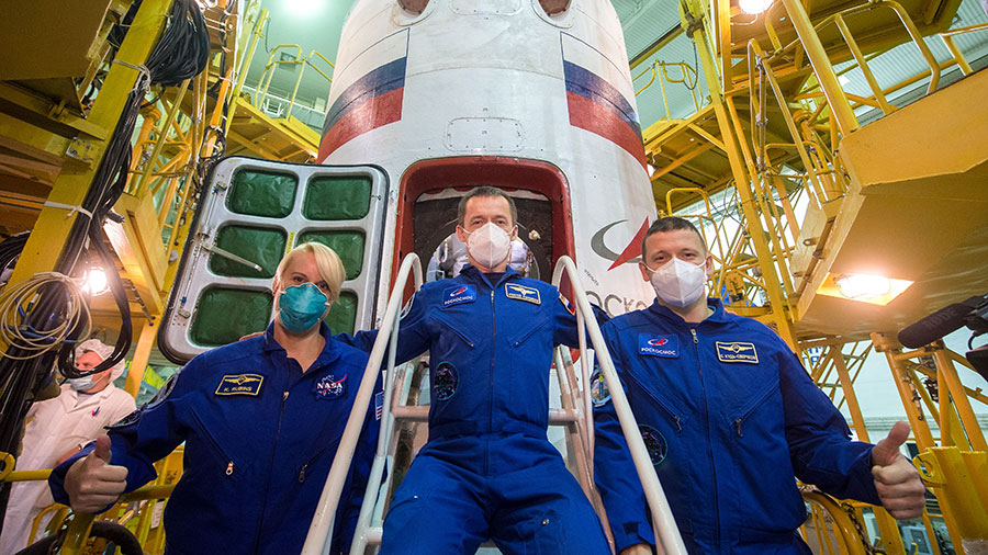 The Expedition 64 crew poses in front of the Soyuz MS-17 spacecraft that will launch the trio to the space station on Oct. 14. Credit: NASA/GCTC/Andrey Shelepin