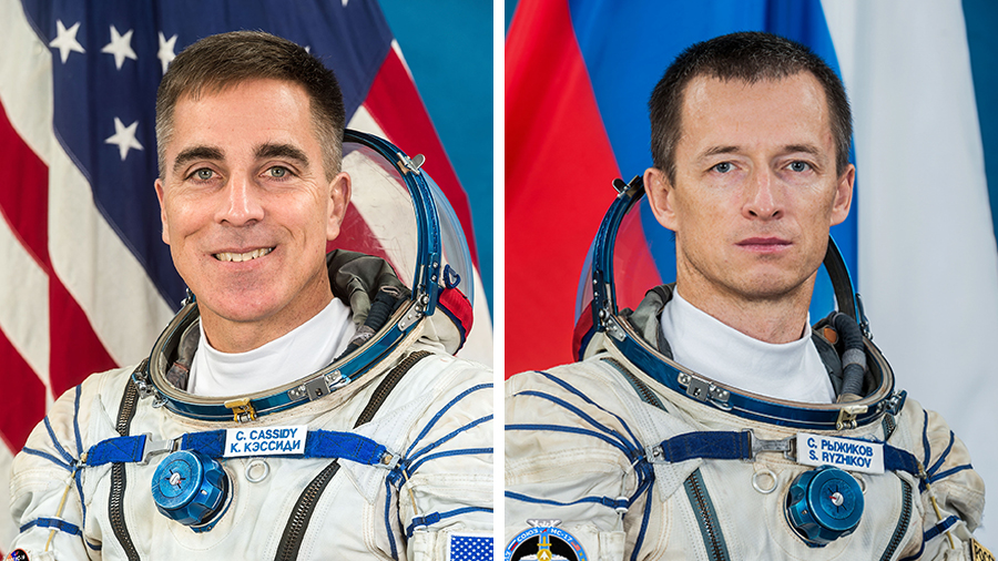 NASA astronaut Chris Cassidy (left) will hand over command of the station to Roscosmos cosmonaut Sergey Ryzhikov (right) today.