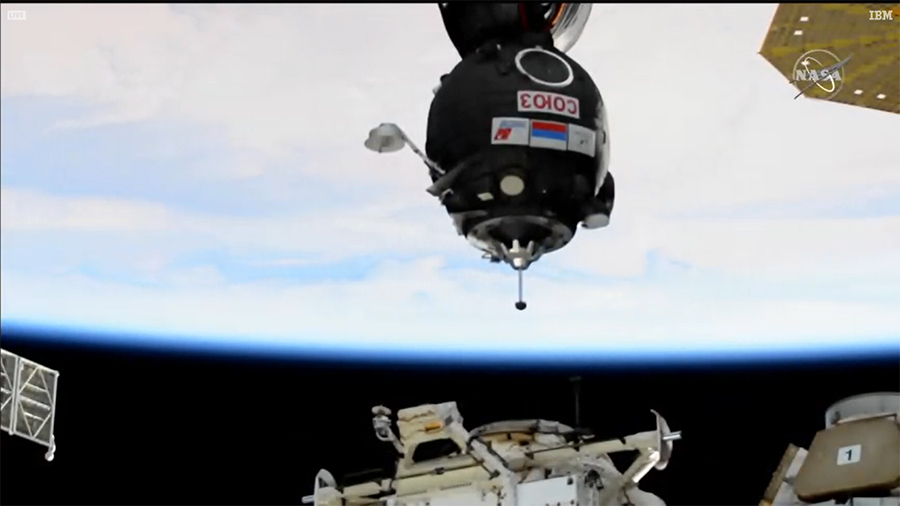 The Soyuz MS-17 crew ship with the Expedition 64 crew inside is pictured just a few meters away from the Rassvet module's docking port.