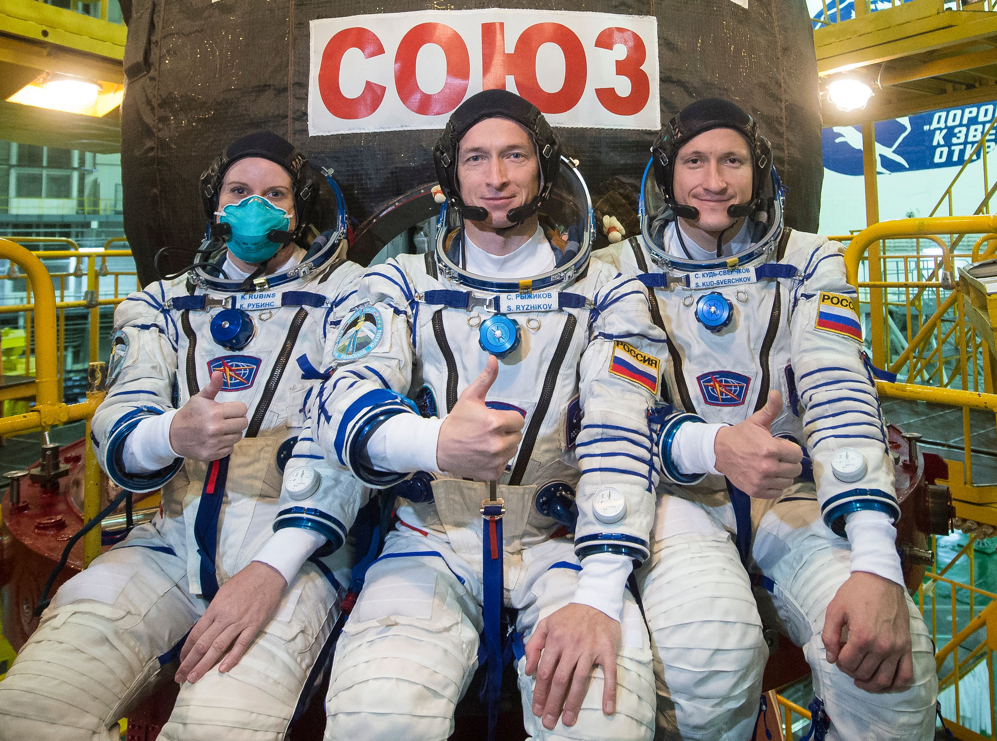 Expedition 64 crew members (from left) Kate Rubins of NASA and Sergey Ryzhikov and Sergey Kud-Sverchkov of Roscosmos in front of the Soyuz MS-17 spacecraft.
