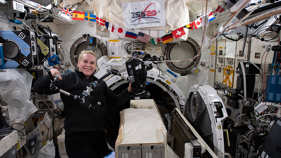 Expedition 64 Flight Engineer Rubins works in Japan's Kibo laboratory module to set up a small satellite deployer.