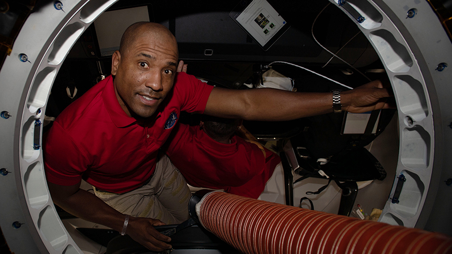 SpaceX Crew-1 Pilot and Expedition 64 Flight Engineer Victor Glover is pictured inside the Crew Dragon vehicle.