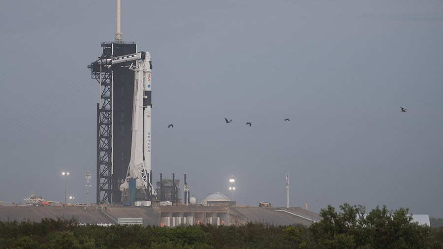 The SpaceX Falcon 9 rocket with the company's Crew Dragon spacecraft atop is seen at its launch pad at NASA's Kennedy Space Center in Florida.
