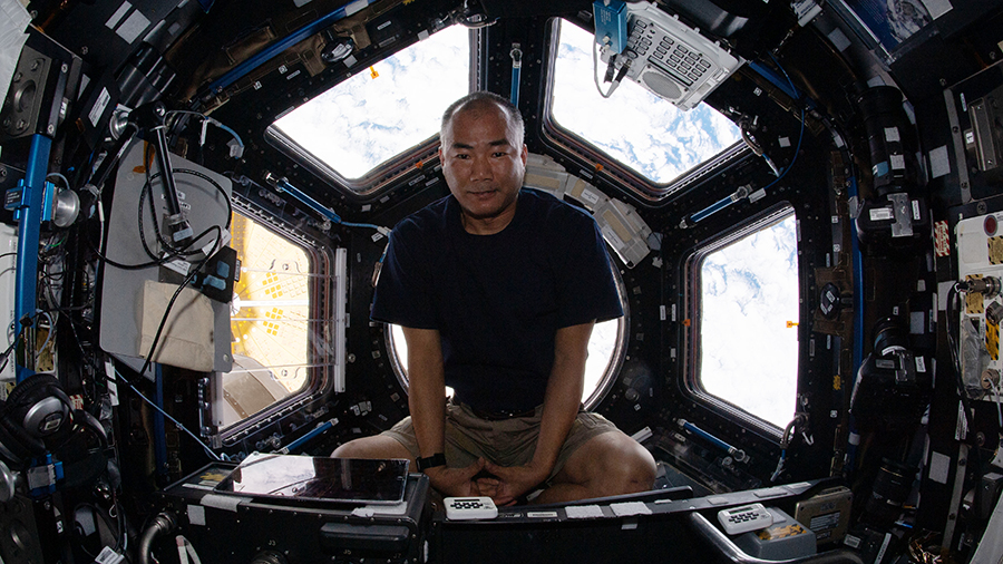 "Expedition 64 Flight Engineer Soichi Noguchi is pictured relaxing at the end of the work day inside the seven-windowed cupola, the International Space Station's ""window to the world."""