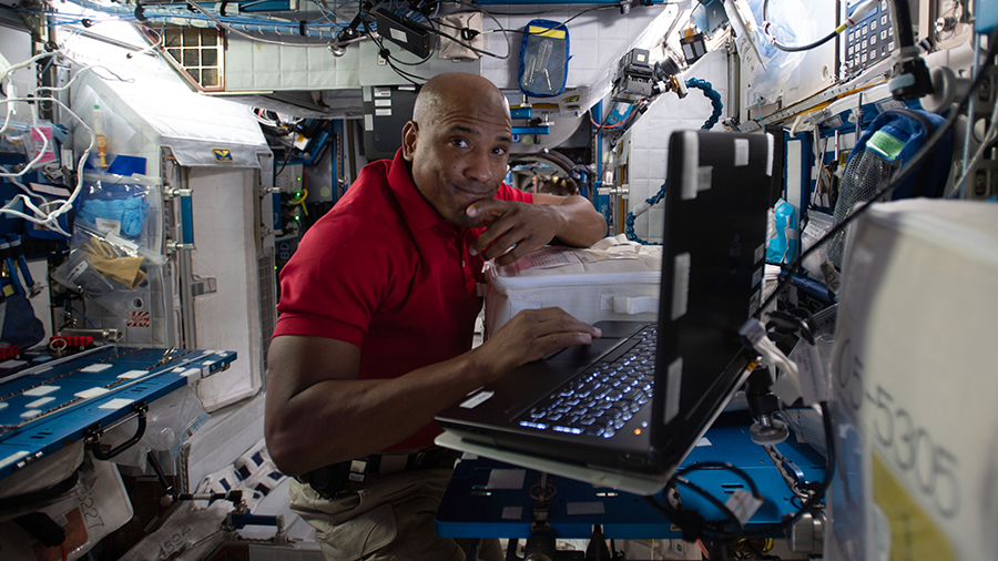 Expedition 64 Flight Engineer Victor Glover reviews research procedures for an experiment that could accelerate the development of advanced therapies that target cancer cells.