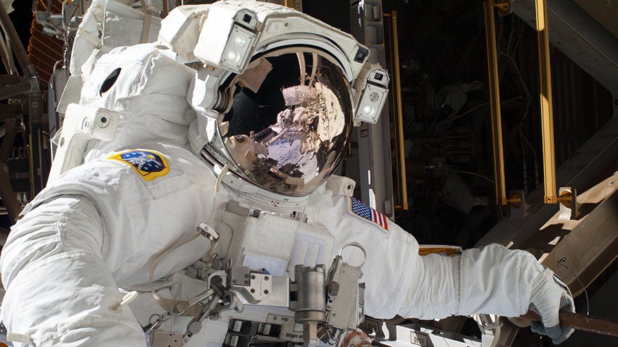 NASA astronaut Mike Hopkins participates in a spacewalk in December of 2013 at the space station during Expedition 38.