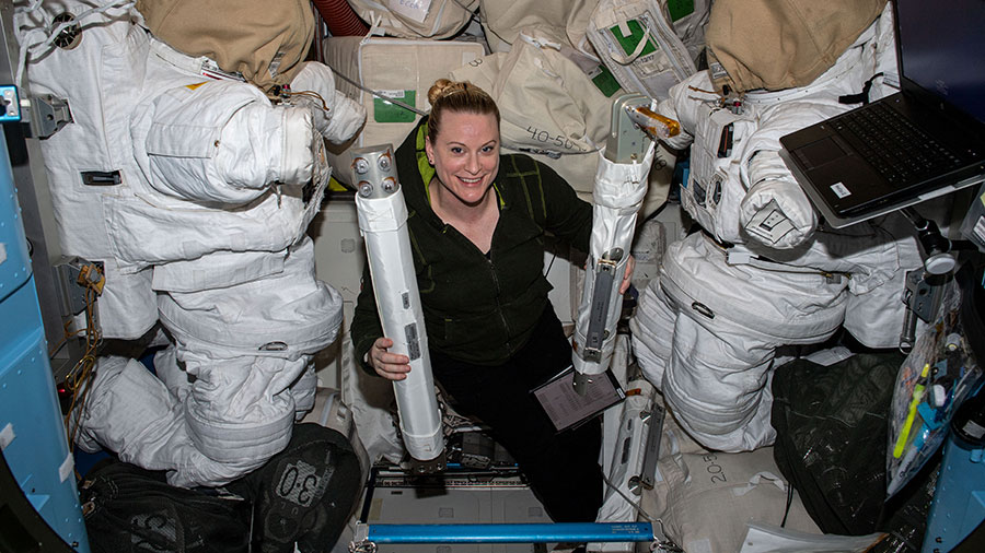 Expedition 64 Flight Engineer Kate Rubins is pictured with spacewalk hardware inside the Quest airlock where spacewalks in U.S. spacesuits are staged.
