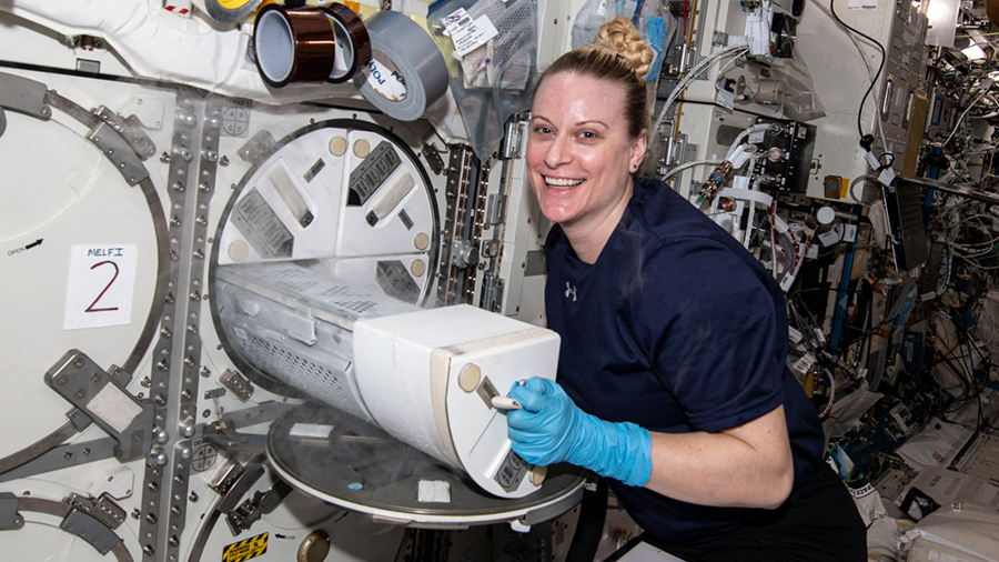 NASA astronaut Kate Rubins loads engineered heart tissue samples into a science freezer for preservation and later analysis.