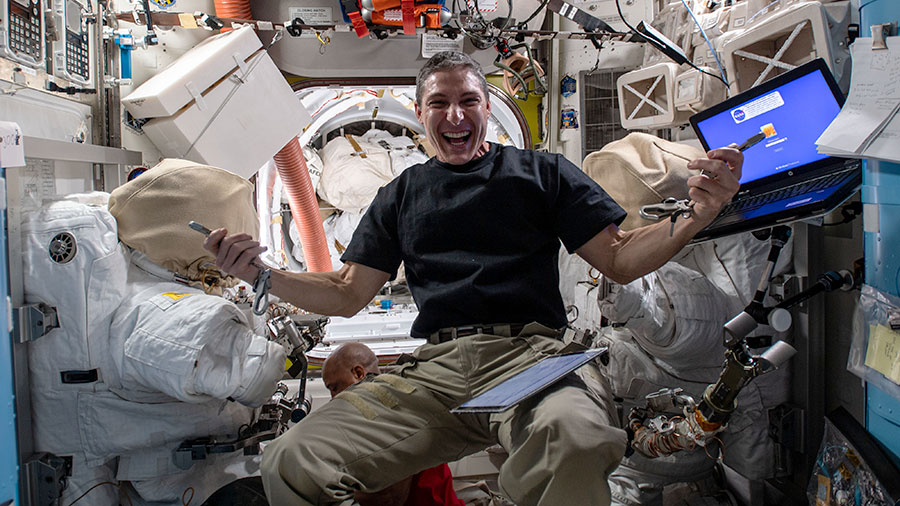 Flight Engineer Michael Hopkins works inside the Quest airlock configuring tools for planned spacewalks to continue maintenance on the outside of the International Space Station.