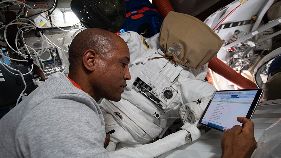 Expedition 64 Flight Engineer Victor Glover works on U.S. spacesuit maintenance inside the Quest airlock of the International Space Station.