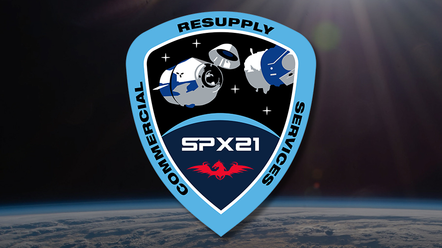 The insignia for the SpaceX CRS-21 mission that saw the upgraded Cargo Dragon resupply ship automatically dock to the Harmony module's space-facing international docking adapter, a first for a U.S. commercial cargo spacecraft.