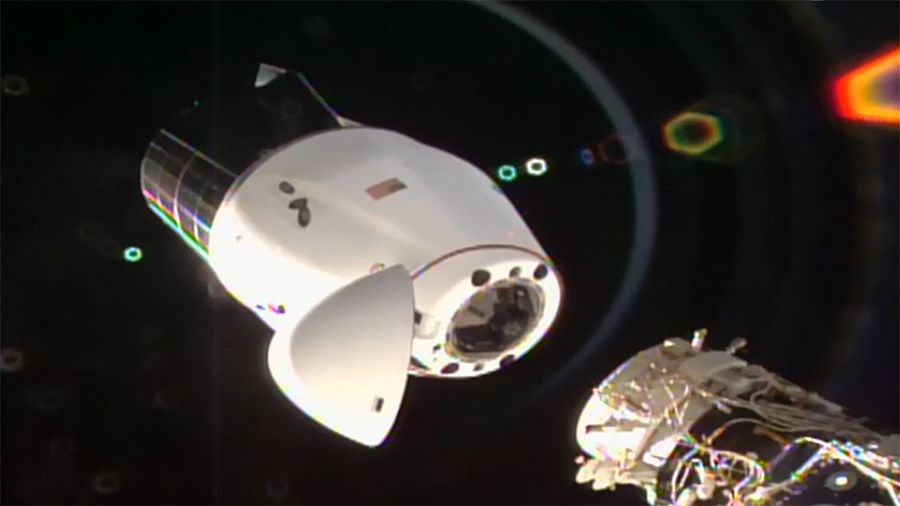 The SpaceX Cargo Dragon vehicle begins its separation from the station after undocking from the Harmony module's international docking adapter. Credit: NASA TV