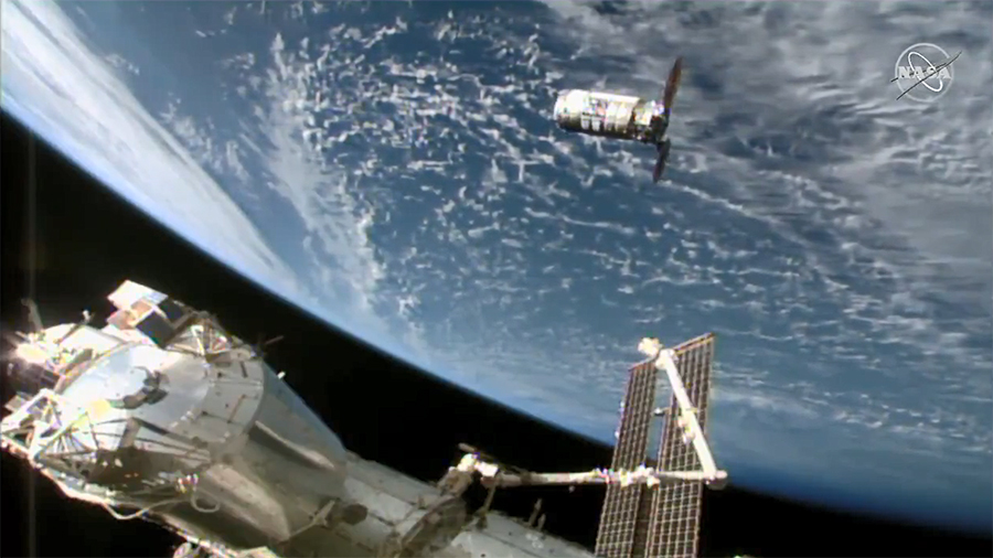 The Northrop Grumman Cygnus resupply ship is pictured about 30 meters away from the space station approaching its capture point near the Canadarm2 robotic arm. Credit: NASA TV
