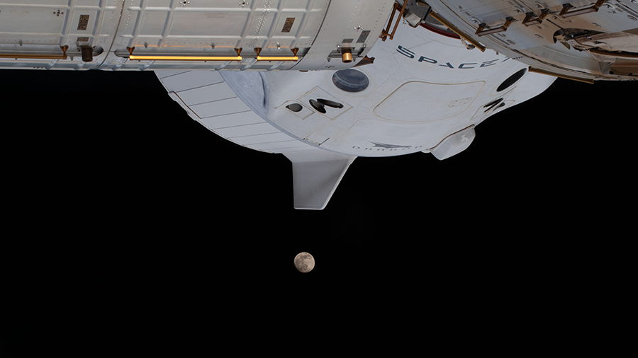 The moon is pictured below the SpaceX Crew Dragon spacecraft as the space station was orbited 263 miles above Atlanta, Georgia.