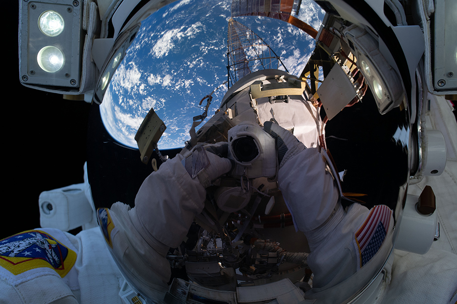 "NASA astronaut Michael Hopkins takes an out-of-this-world ""space-selfie"" during Monday's spacewalk."