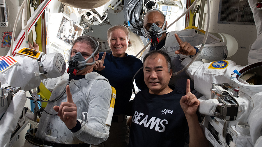 Clockwise from bottom right are, Expedition 64 Flight Engineers and SpaceX Crew-1 members Soichi Noguchi, Michael Hopkins, Shannon Walker and Victor Glover during spacewalk preparations inside the U.S. Quest airlock.