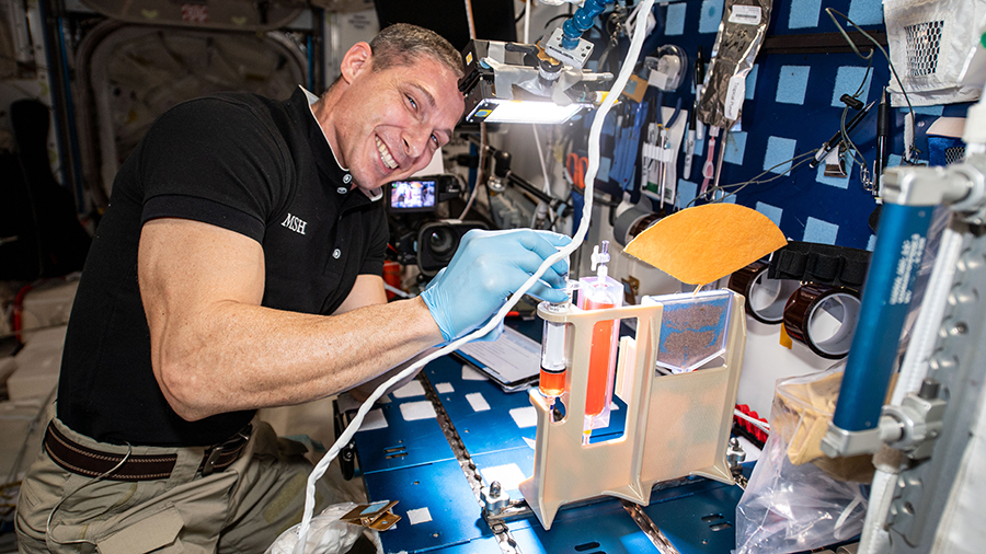 Expedition 64 Flight Engineer Michael Hopkins works on hydroponics components for the Plant Water Management study.