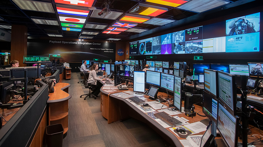 Payload controllers are pictured working inside the Payload Operations Integration Center, the science command post for the space station located at NASA's Marshall Space Flight Center in Huntsville, Ala.