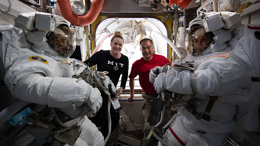 NASA spacewalkers (front left) Victor Glover and Michael Hopkins are pictured with (rear left) astronauts Kate Rubins and Soichi Noguchi before the start of spacewalk on  Jan. 27, 2021.