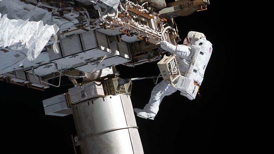 Expedition 64 Flight Engineer Victor Glover works during a spacewalk on Jan. 27, 2021 to set up the space station for future solar array upgrades.