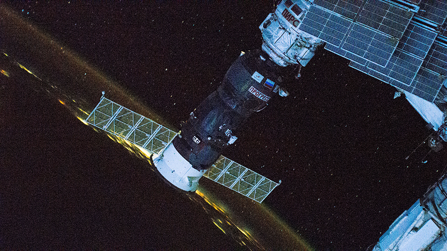Russia's ISS Progress 77 cargo craft is pictured attached to the space station while orbiting 260 miles above the Gulf of Mexico.