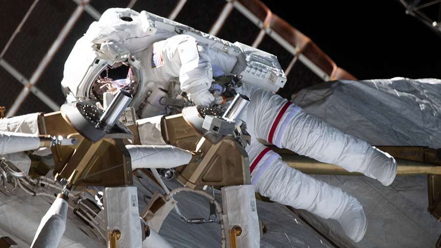NASA astronaut Kate Rubins is pictured during a spacewalk to install solar array modification kits on the space station.