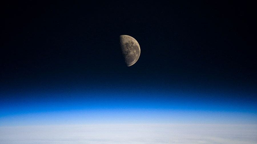 The Last Quarter Moon is pictured above the Earth's horizon as the station orbited over the Indian Ocean.