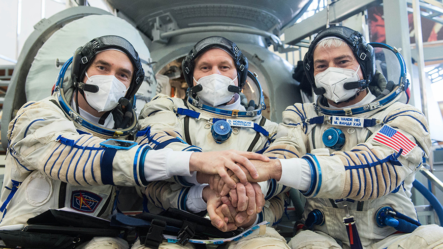 (From left) Expedition 65 crew members Pyotr Dubrov, Oleg Novitskiy and Mark Vande Hei, pose for a photo during Soyuz qualification exams in Moscow.