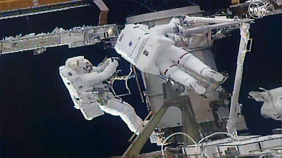 (From left) Astronauts Kate Rubins and Soichi Noguchi work to install a solar array modification kit during the fourth spacewalk of both of their careers. Credit: NASA