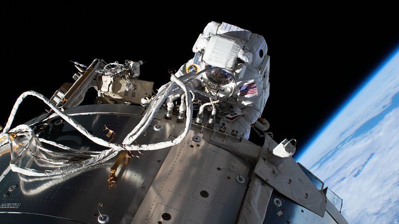 NASA astronaut and Expedition 64 Flight Engineer Michael Hopkins is pictured during a spacewalk on March 13, 2021, servicing communications gear on the outside of the International Space Station's Columbus laboratory module. Credits: NASA