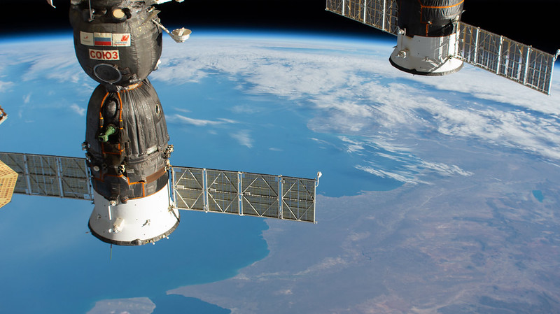 Two Russian spacecraft are seen docked to the International Space Station as it orbited 269 miles above southern Argentina. At left is the Soyuz MS-17 crew ship that will soon undock from the Rassvet module and relocate to the Poisk module, making room for three new crew members due to launch April 9 aboard the Soyuz MS-18 crew ship. At right is the aft end of the Progress 77 cargo craft docked to the Pirs docking compartment. Credits: NASA
