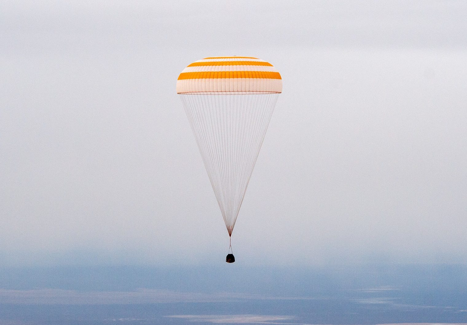 The Soyuz MS-16 spacecraft is seen as it lands in Kazakhstan with Expedition 63 crew.
