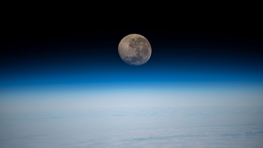 A waning gibbous Moon is pictured above the Earth's horizon as the space station orbited 269 miles above the Atlantic Ocean.