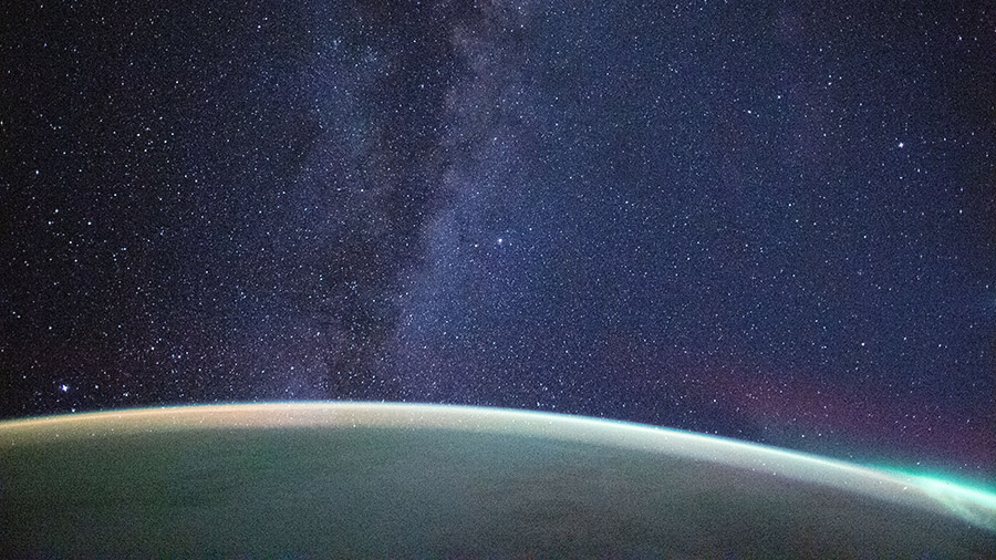 The Milky Way extends above the Earth's horizon in this long exposure photograph from the space station.