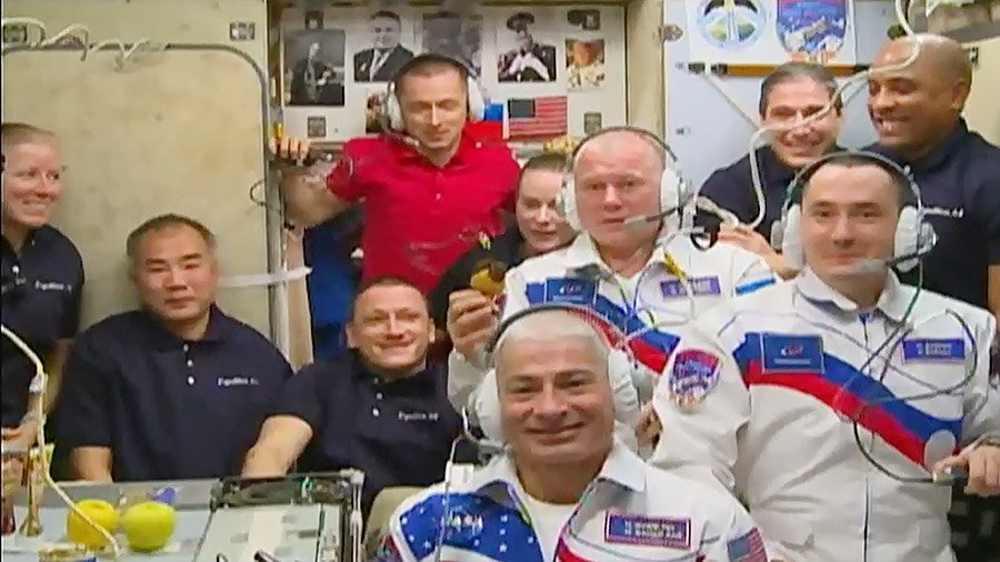 The newly-expanded 10-member station crew gathers in the Zvezda service module for a welcoming ceremony with family members and mission officials on Earth. Credit: NASA TV