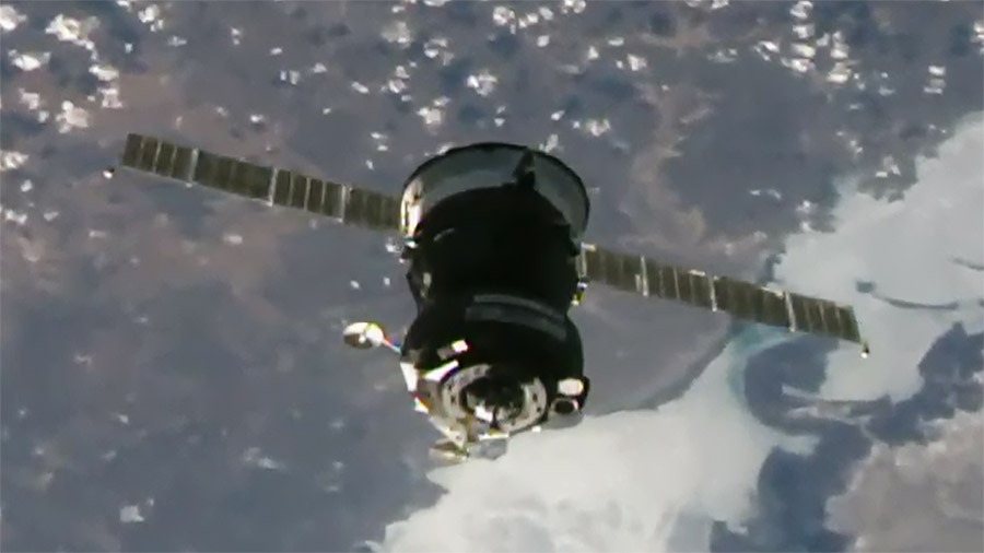 The Soyuz MS-18 crew ship is pictured on final approach to its docking port on the space station's Rassvet module.